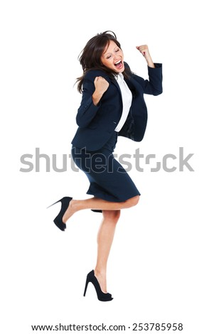Businesswoman punching the air full of joy isolated on white background, expressing success - stock photo