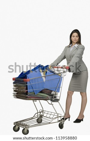 Businesswoman pushing a shopping cart filled with files