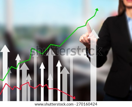 Businesswoman pushing the graph on visual screen. Women finger on growth line. Business stock, technology concept. Isolated on office. Stock Image