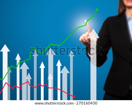 Businesswoman pushing the graph on visual screen. Women finger on growth line. Business stock, technology concept. Isolated on blue. Stock Image - stock photo
