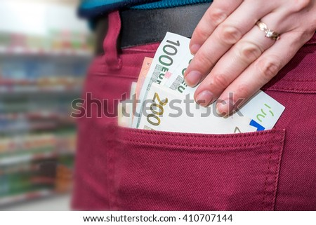 Businesswoman  putting euro money banknotes in pocket
