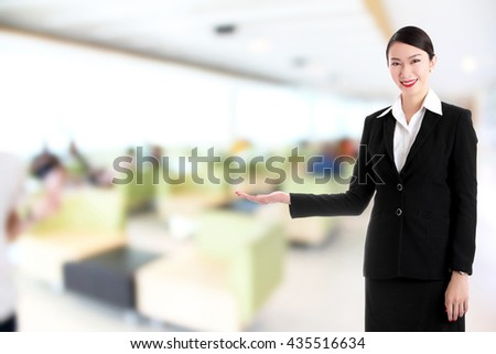 businesswoman raise hand to present with blur hospital background