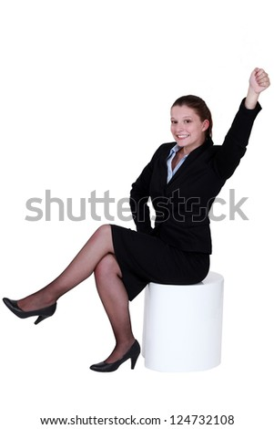 Businesswoman reaching into the air - stock photo