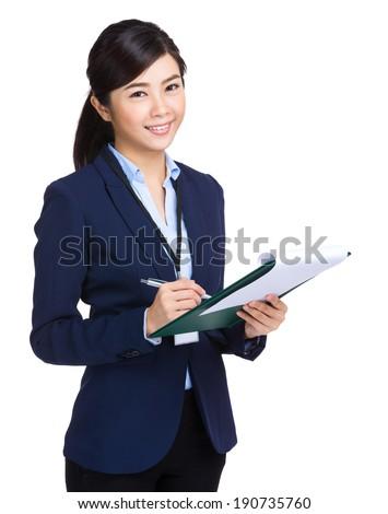 Businesswoman record on clipboard - stock photo