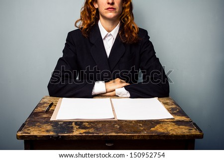 Businesswoman refusing to sign contract - stock photo