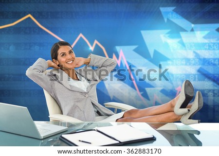 Businesswoman relaxing in a swivel chair against stocks and shares - stock photo