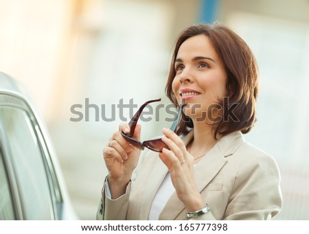Businesswoman relaxing outdoors - stock photo