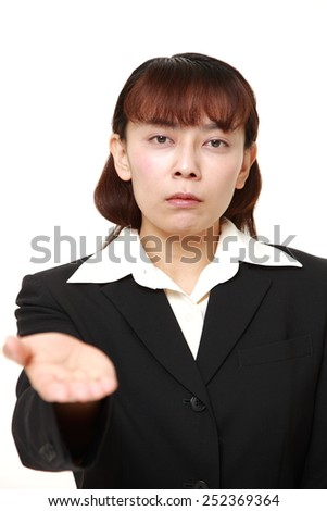 businesswoman requests something - stock photo