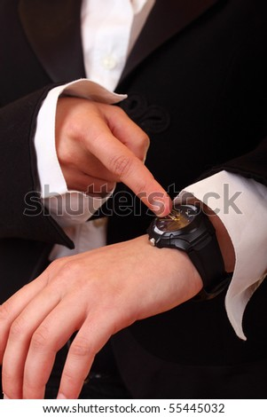businesswoman?s hand pointing  the time on wristwatch
