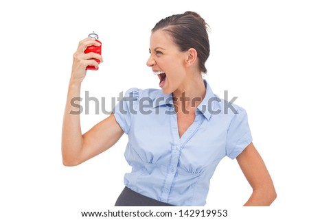 Businesswoman screaming at alarm clock on a white background