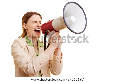 Businesswoman screaming loudly in a big megaphone