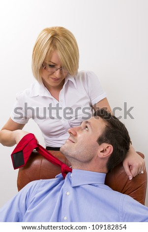 Businesswoman seducing her manager at office. - stock photo