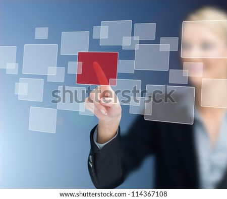 Businesswoman selecting red square against blue background