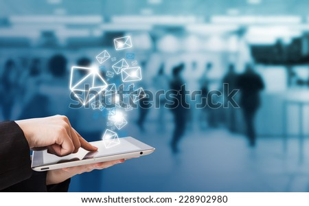 Businesswoman sending email by digital tablet in skytrain station  - stock photo