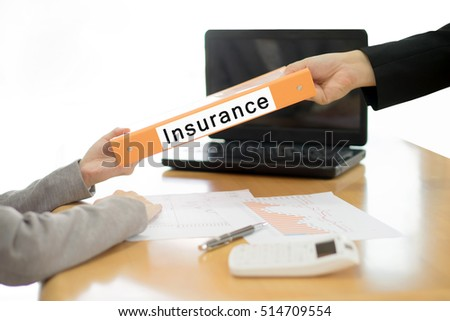 Businesswoman sends the insurance document to the businessman. selective focus.