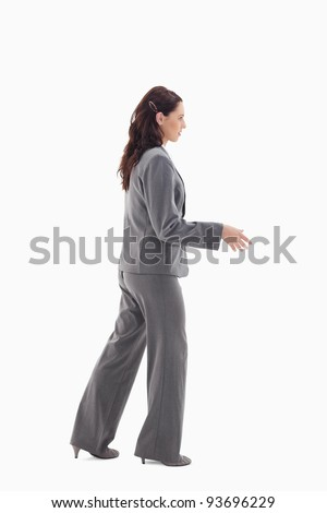 Businesswoman shaking a hand against white background - stock photo