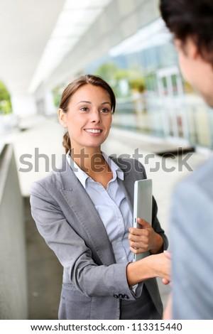 Businesswoman shaking hand to partner - stock photo