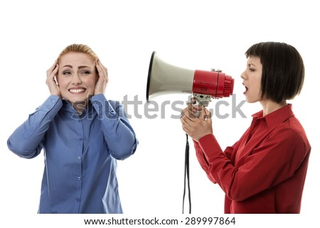 Businesswoman shouting at another woman using a bullhorn
