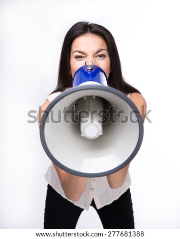 Businesswoman shouting in megaphone isolated on a white background. Looking at camera