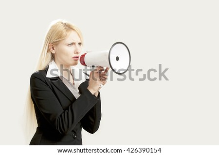 Businesswoman shouting into a megaphone isolated on white