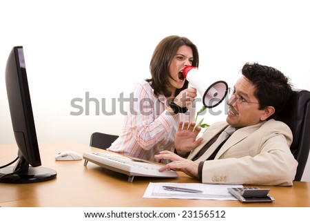 businesswoman shouting with her office worker (selective focus) - stock photo