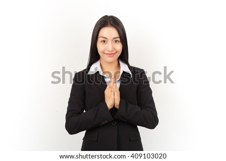 Businesswoman show thai greeting style.Isolated with write background.