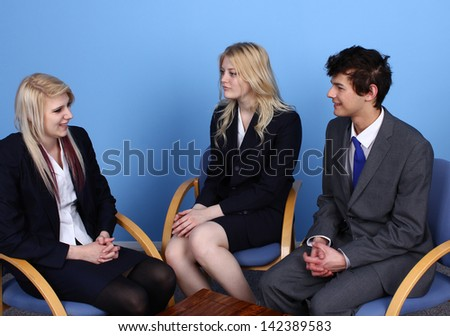 Businesswoman  Showing A Paper To A Businessman In Office