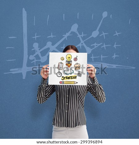 Businesswoman showing a white card in front of her face against blue background - stock photo
