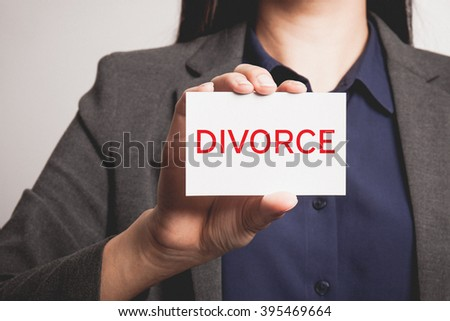 Businesswoman showing and handing a divorce card. - stock photo