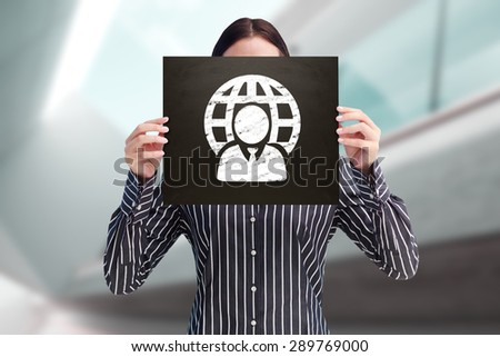 Businesswoman showing board against modern home with large windows - stock photo