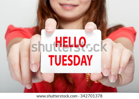 Businesswoman showing card with hello tuesday message, - stock photo