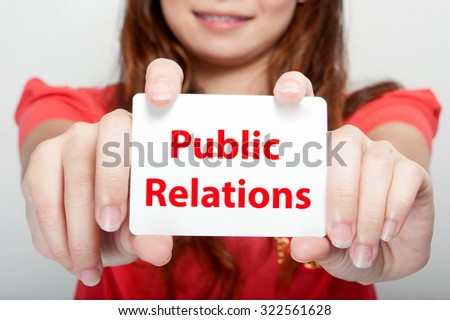 Businesswoman showing card with public relations message - stock photo