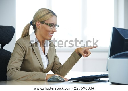 Businesswoman showing content on the computer