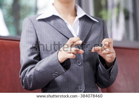 Businesswoman showing empty handed at desk.