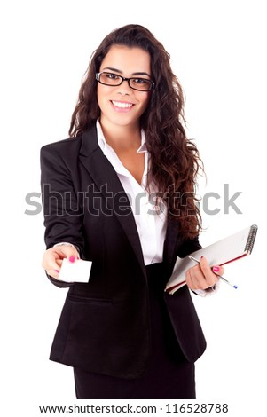 Businesswoman showing greeting card - selective focus on hand - stock photo