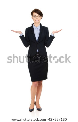 Businesswoman showing two empty hands. - stock photo