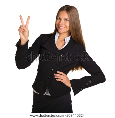 Businesswoman showing victory sign - stock photo