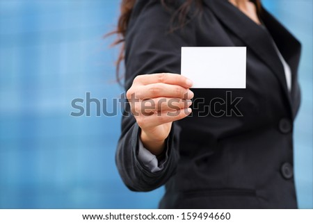 Businesswoman showing white empty business card. - stock photo