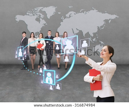 businesswoman shows social network structure her team. Elements of this image furnished by NASA