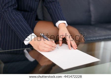 Businesswoman sign blank paper in formal wear closeup - stock photo