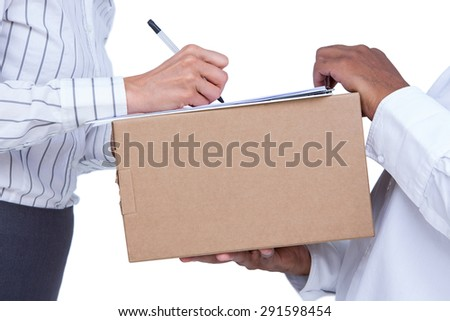 Businesswoman signing papers for package on white background - stock photo