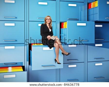 businesswoman sit on drawer of  cabinet folder - stock photo