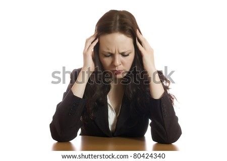 Businesswoman sits at desktop isolated on white.