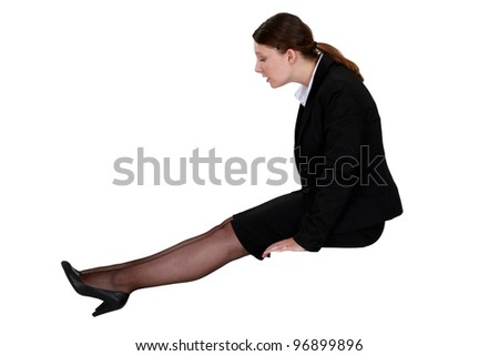 businesswoman sitting and watching her shoes