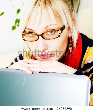 businesswoman sitting at a desk with a laptop - stock photo
