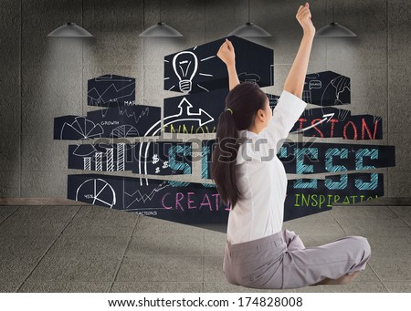 Businesswoman sitting cross legged cheering against dark room with lamps - stock photo