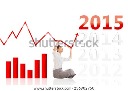 Businesswoman sitting cross legged pushing up against 2015 - stock photo