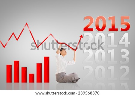 Businesswoman sitting cross legged pushing up against grey vignette - stock photo
