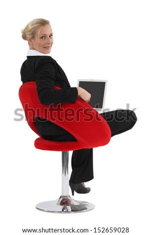 Businesswoman sitting in a chair - stock photo