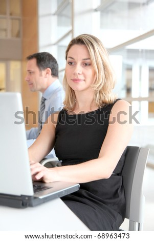 Businesswoman sitting in the office in front of laptop